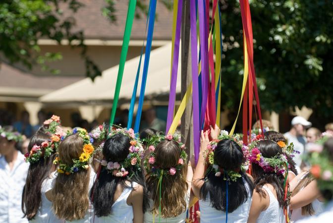 Maypole dancers gather around the Maypole