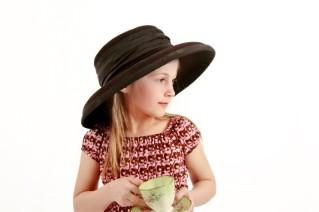 girl in a hat with teacup