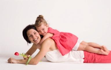 young mother with daughter on her back