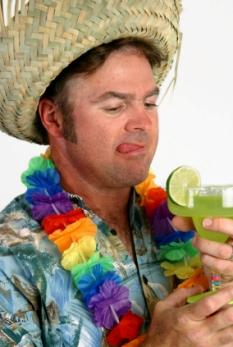 Man in Hawaiian shirt and hat