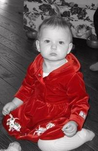 baby in red dress