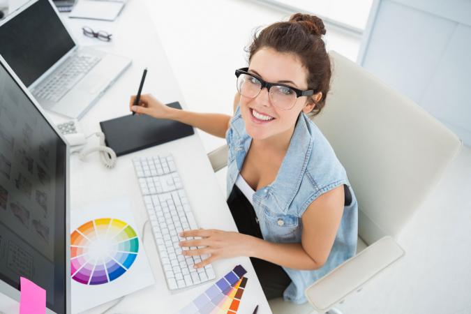 Woman using Photoshop on computer