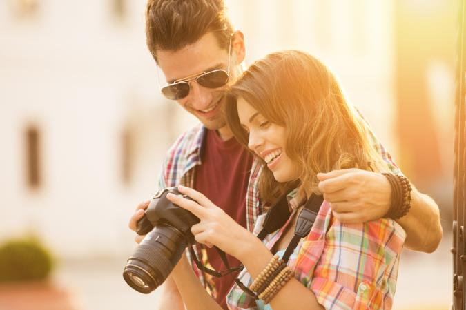 happy couple with camera