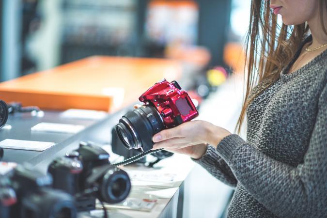 Female customer holding digital camera
