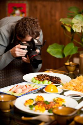 A photographer takes a close-up of a dish of food.