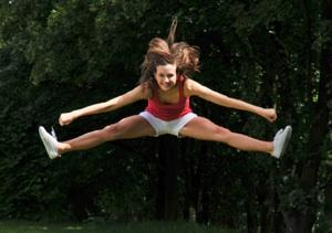 Cheerleader Toe Touch Photos http://photography.lovetoknow.com/Cheerleading_Action_Photography