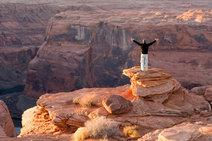 man standing on ridge of Grand Canyon