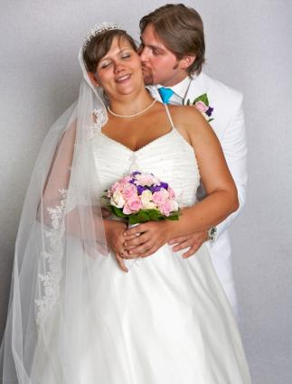 Full-figured bride with her groom