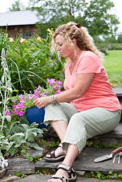 Woman wearing capris and gardening
