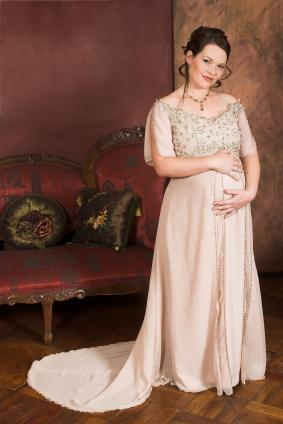 Pregnant woman in a formal gown