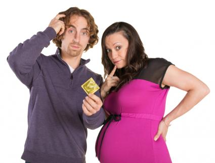 pregnant couple with condom