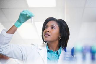 Lab technician examining test tube