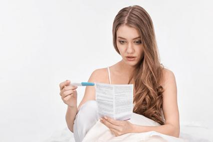 Woman reading pregnancy results