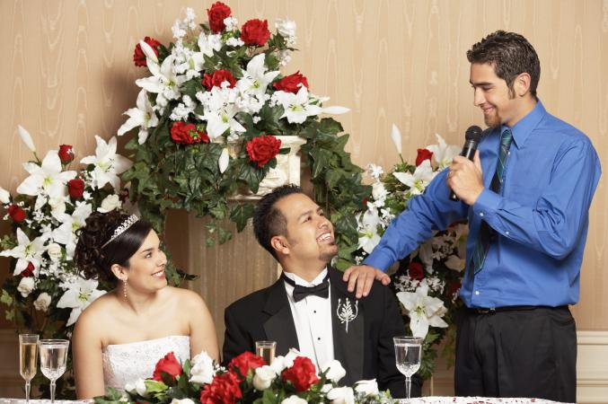 Man speaking to bride and groom