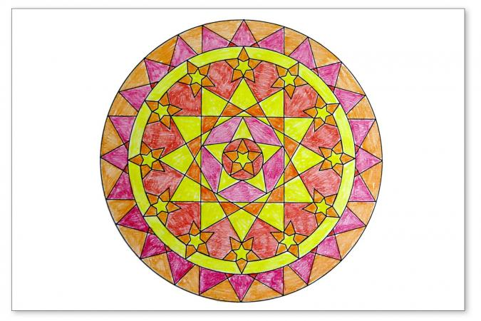 simple mandala colored in oranges, yellow, red