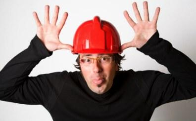 Man with hardhat sticking tongue out