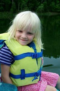 Young girl on boat wearing lifejacket