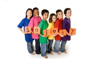 children holding safety sign