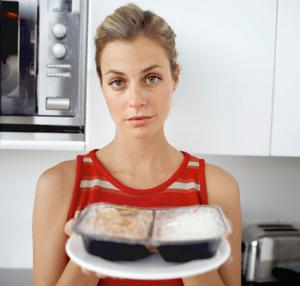 Woman holding microwaved food