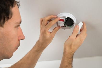 Electrician With Smoke Detector