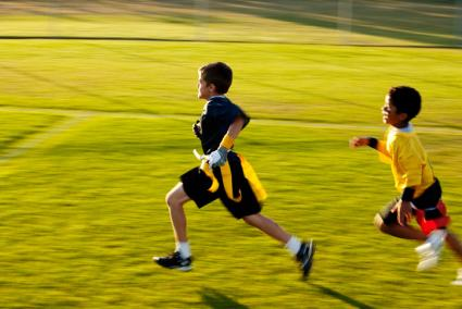 Child chasing another in flag tag