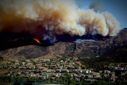 Fire and smoke covered mountains above neighborhood