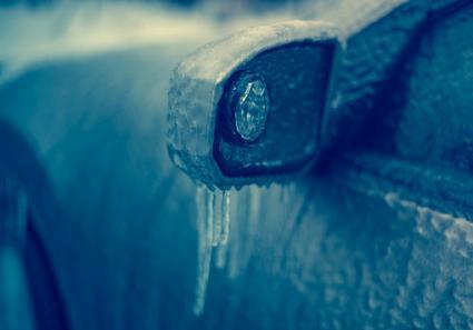 Frozen car in ice storm