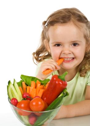 Child eating fresh vegetables