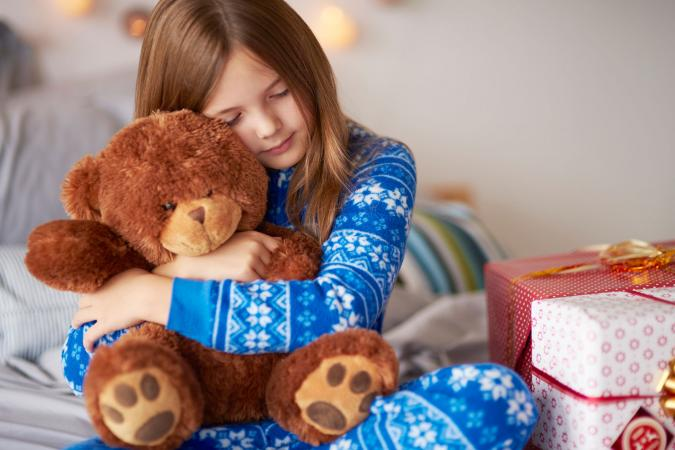 Child with teddy bear present