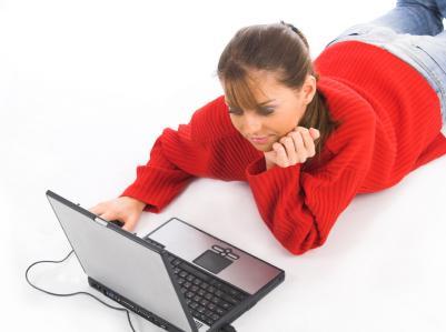 woman using laptop to scrapbook