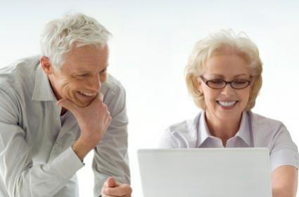 retired couple looking at digital scrapbook