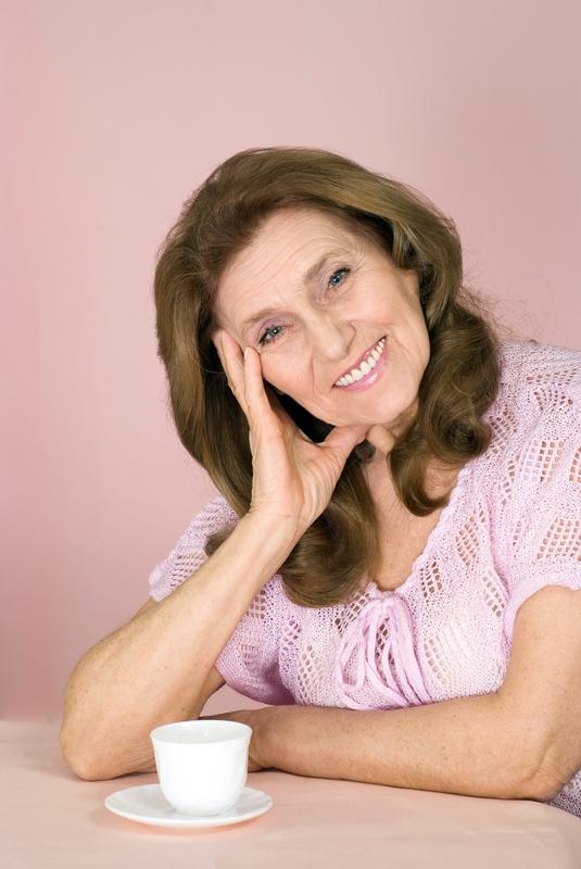 elderly woman with long brown hair. © Ruslan Huzau | Dreamstime.com