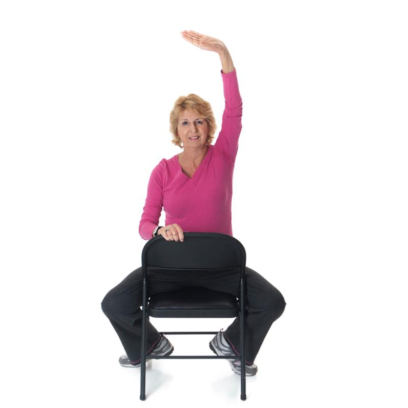 Woman in chair stretching