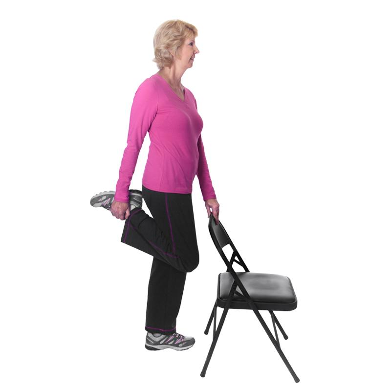 Woman doing quad stretch with chair