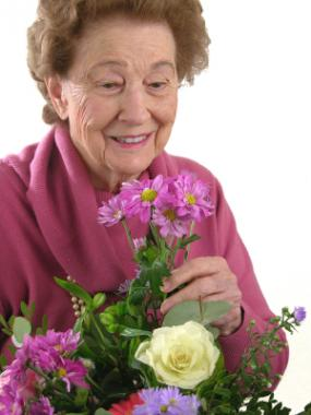 Senior woman creating a floral arrangement