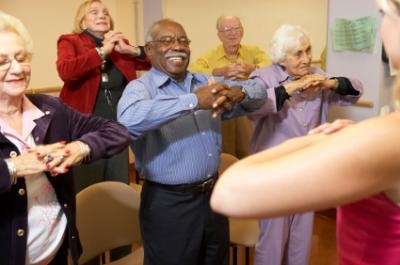 Seniors attending a stretching class at the senior center