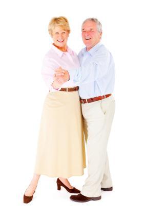 Happy retired couple dancing