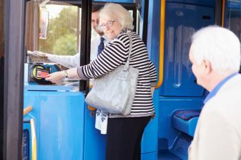Seniors boarding a bus