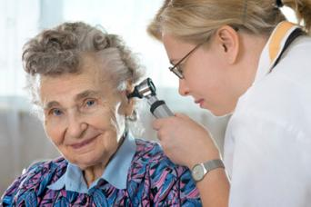 Senior woman having a hearing exam