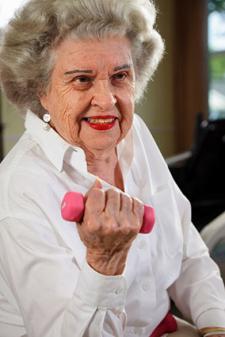 Senior woman doing bicep exercise