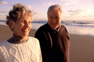 Senior couple enjoying the beach