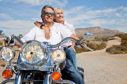 couple sitting on motorcycle
