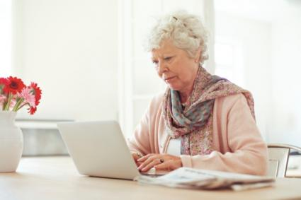 Elderly woman using laptop