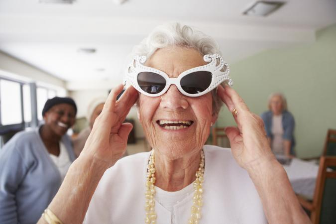 Elderly woman having fun