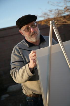 Senior painting a canvas