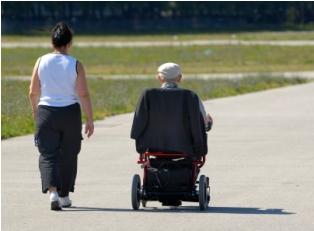 Senior citizen receiving assistance
