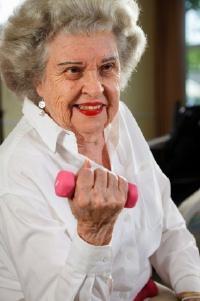 An elderly woman exercising