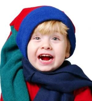 Boy wearing a multi-colored fleece stocking cap
