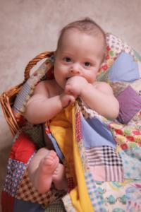 baby with quilt
