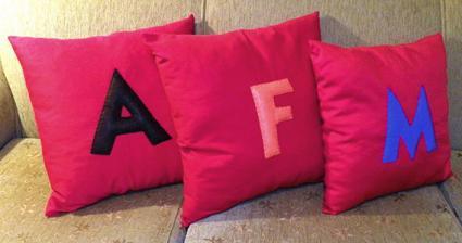 Pillow with felt letter applique